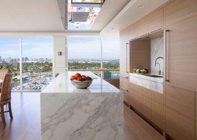 granite waterfall kitchen island in Hockney Meets Mexico condo by Twist Interior Design