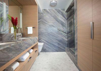 granite stone master bath in Hockney Meets Mexico condo by Twist Interior Design