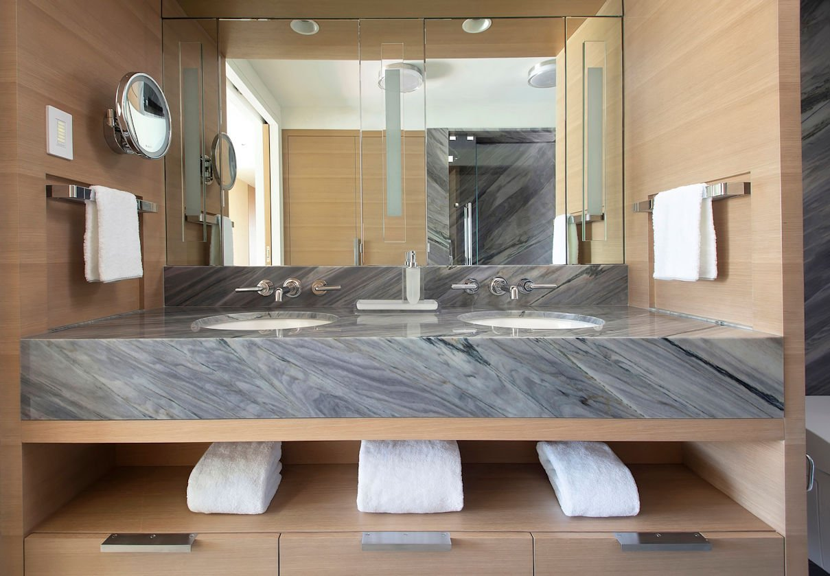 granite stone bathroom vanity in Hockney Meets Mexico condo by Twist Interior Design