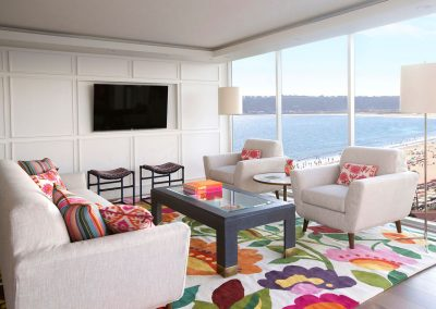 Colorful living room in Hockney Meets Mexico condo by Twist Interior Design