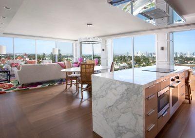 Waterfall kitchen island in Hockney Meets Mexico condo by Twist Interior Design